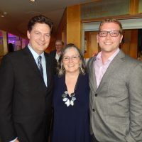 New executive direction Rob Gloor, left, with marketing director Elaine McHarg and VIP guest Rob Severin