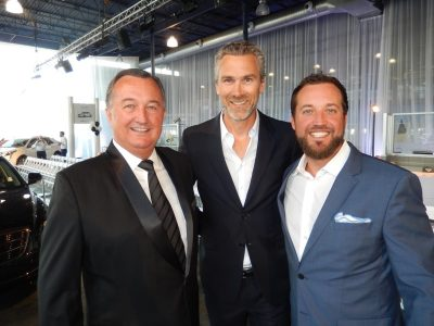 Dueck's Moray Keith, left, son Greg, right, with Canucks celebrity Trevor Linden