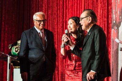 West Vancouver's Amin Lalji, left, on stage with gala co-chair Carol Lee and father Robert H. Lee. Both families donated $1 million each