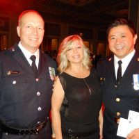 VPD Staff Sgt. Mark Horsley, left, with Lisa Rossington and VPD Superintendent Howard Chow