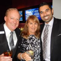 A4K director Craig Knapton, left, and wife Becky greet guests with Hard Rock Casino's Raj Mutti.