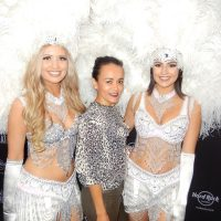 Cassiana Blank with the Vegas showgirls in the reception lobby.