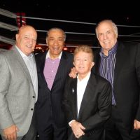 VIP ringside seats for John Teti, left, Wally Oppal, Tommy Wolski and Bruce Allen.